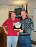 Jeff Najmowicz and presents Dan Wagner with his 2008 Angler of the Year and Mr. Bass Trophy.